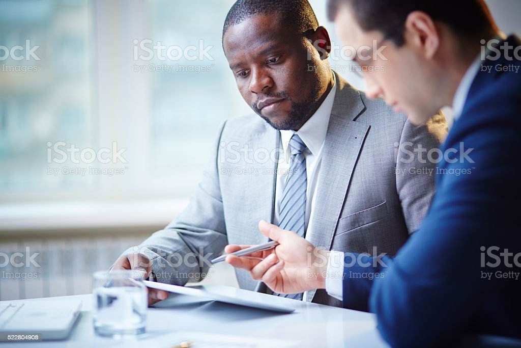 Serious managers stock photo