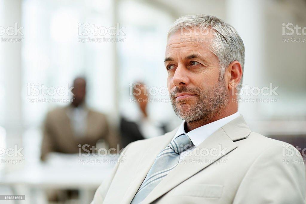 Serious mature businessman thinking royalty-free stock photo