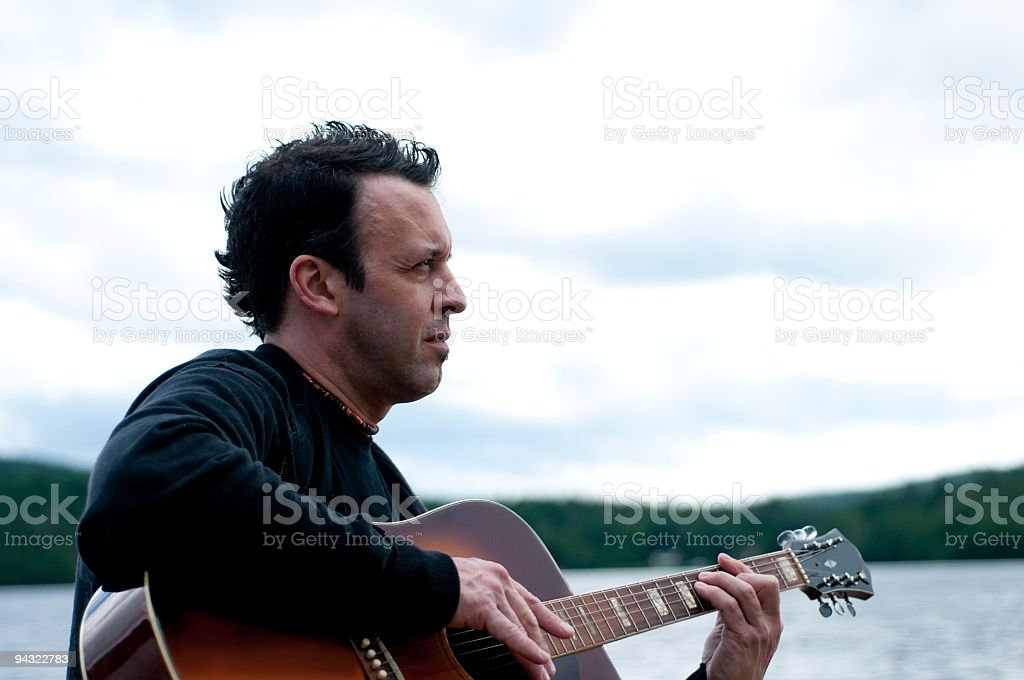 serious mature musician stock photo