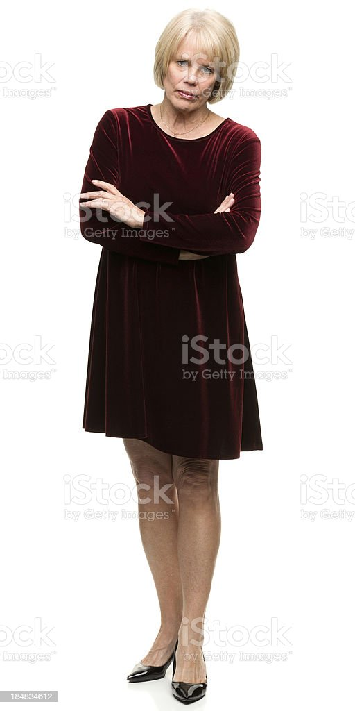 Serious Mature Woman Crosses Arms stock photo