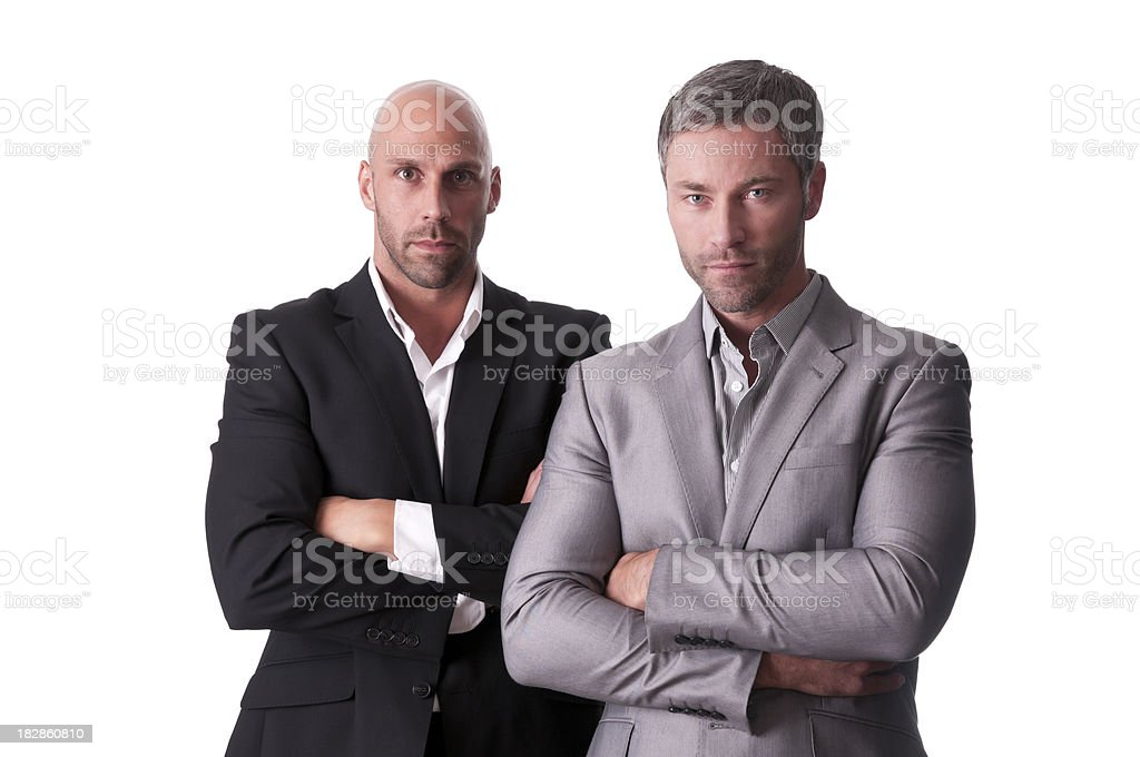 serious men with arms crossed royalty-free stock photo