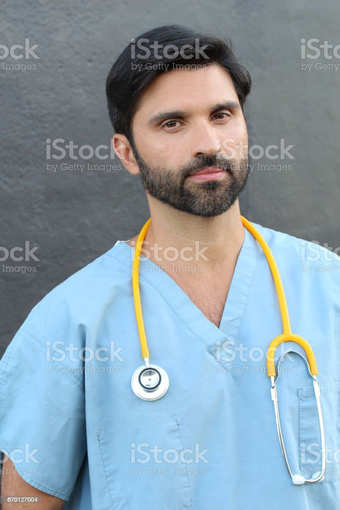 Serious mid adult male health care worker stock photo