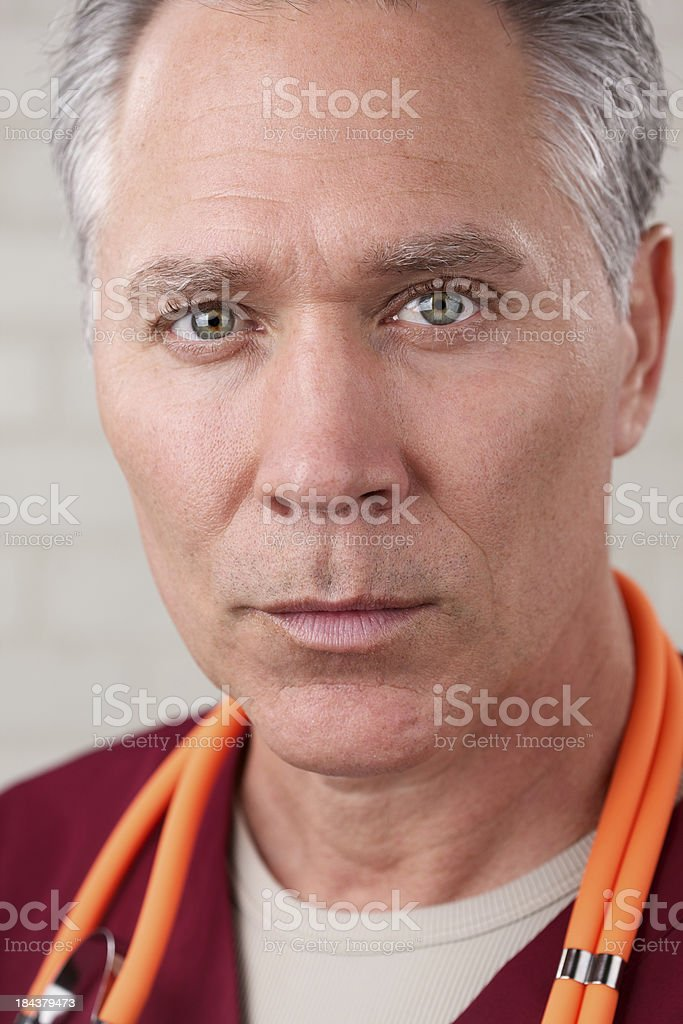 Serious middle age male health care worker royalty-free stock photo