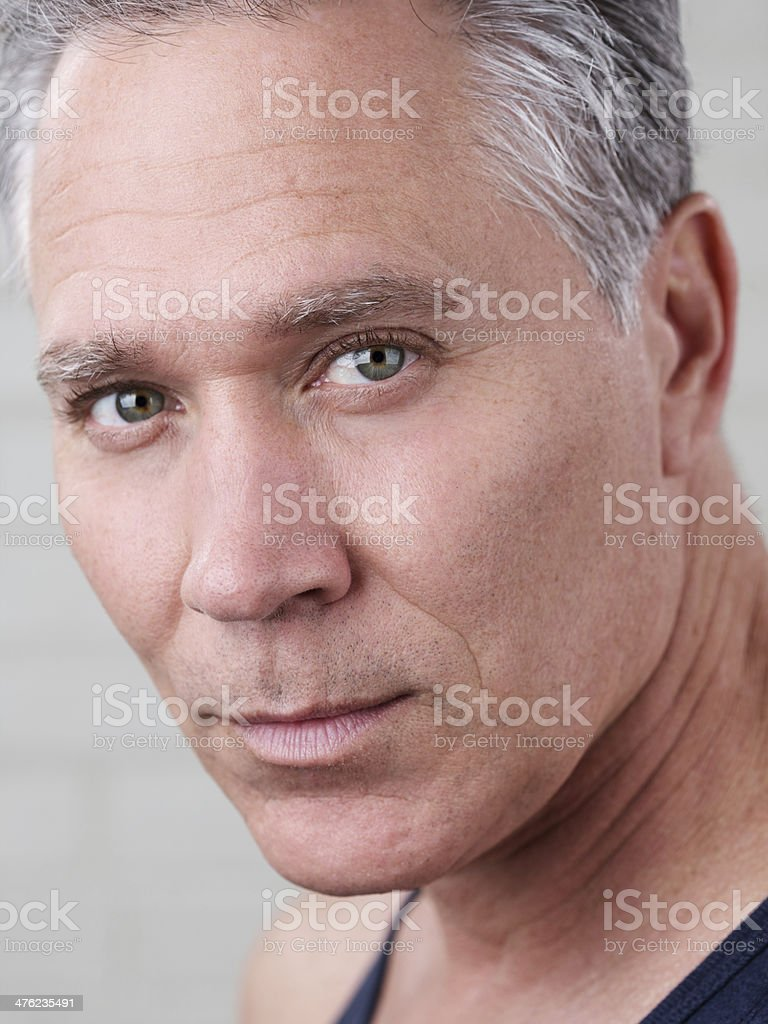 Serious middle age man with gray hair and tank top royalty-free stock photo