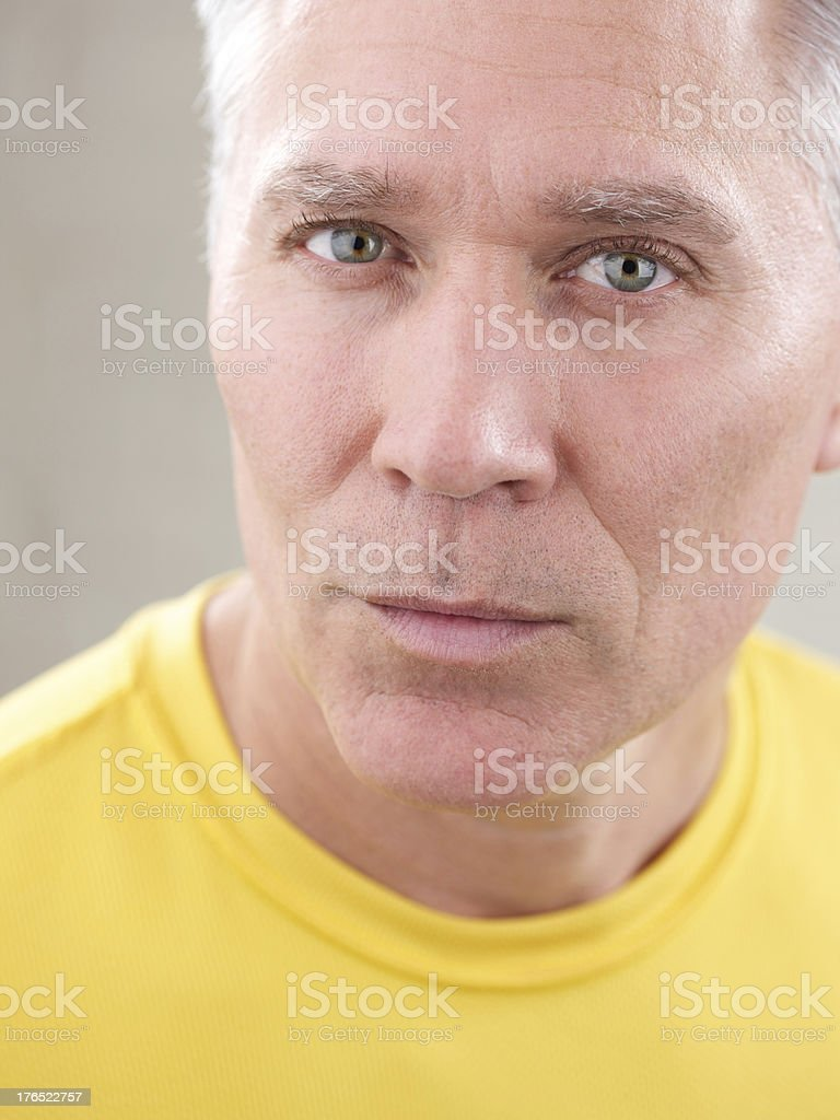 Serious middle age man with gray hair royalty-free stock photo