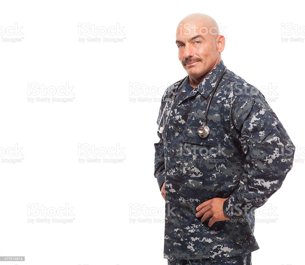 Serious Navy doctor on white background. stock photo