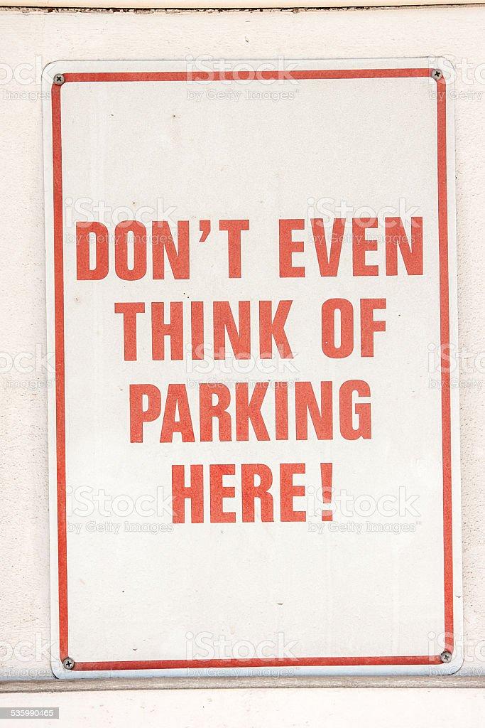 Serious No Parking Sign stock photo