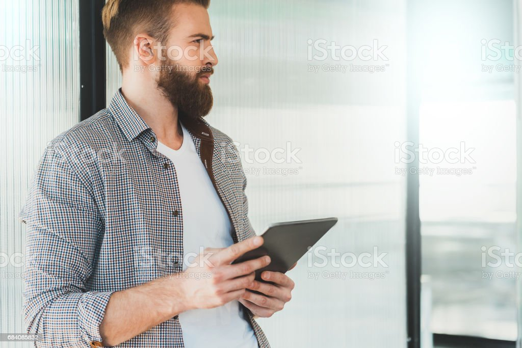 Serious office worker keeping device stock photo