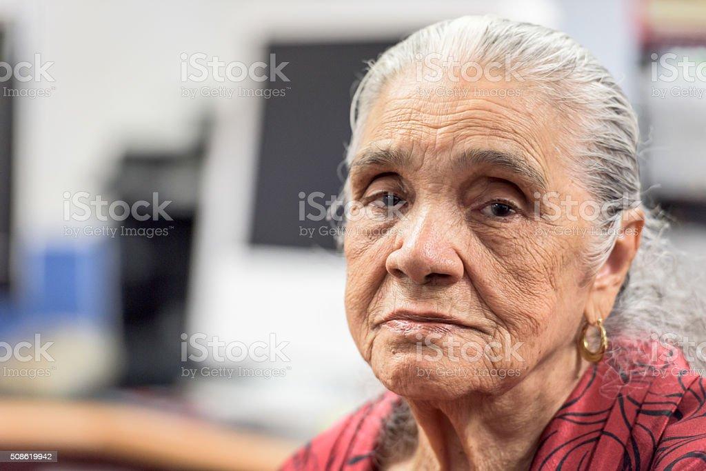 Serious old hispanic senior woman stock photo
