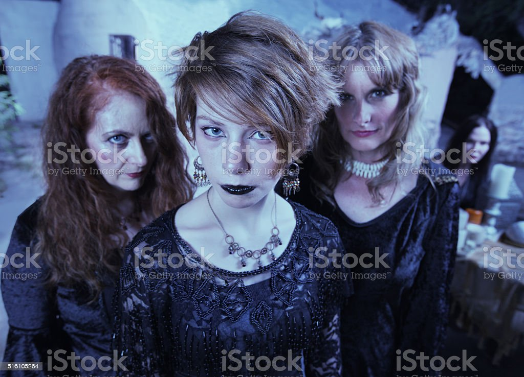 Serious Pagan Women in Black stock photo