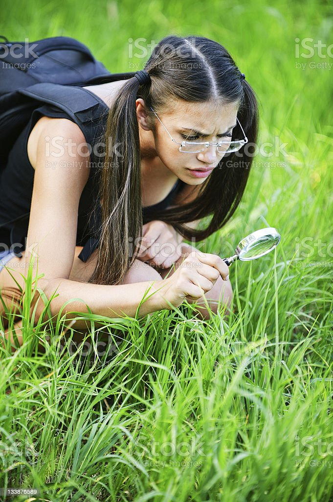 serious pensive woman glasses magnifying glass royalty-free stock photo