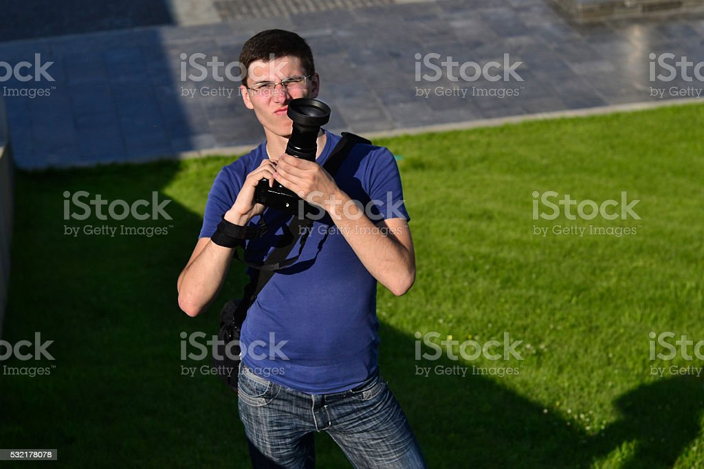 Serious photographer with camera stock photo