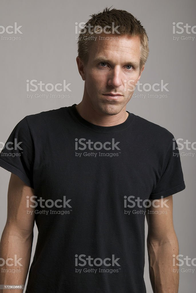 Serious Portrait of Young Man in Black T-Shirt royalty-free stock photo