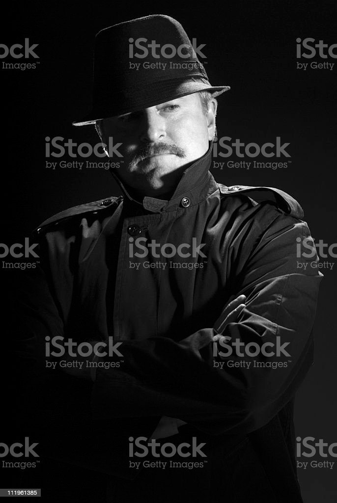 Serious priviate eye in film noir style stock photo