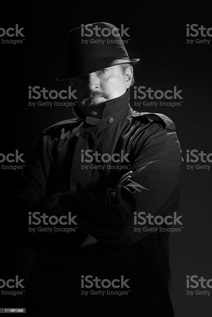 Serious priviate eye in film noir style royalty-free stock photo