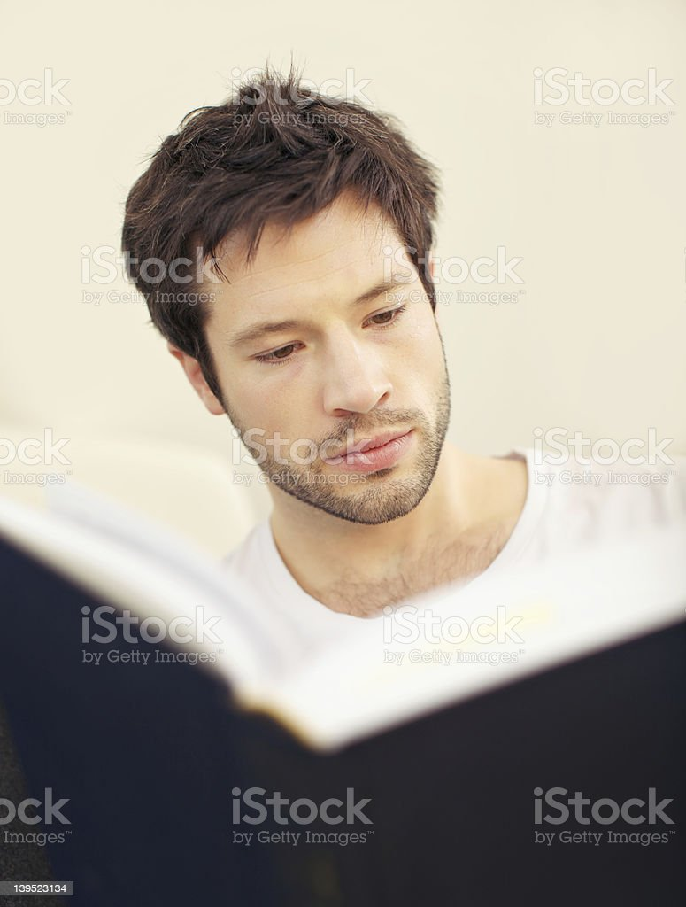 Serious Scholar With Large Teaxtbook royalty-free stock photo