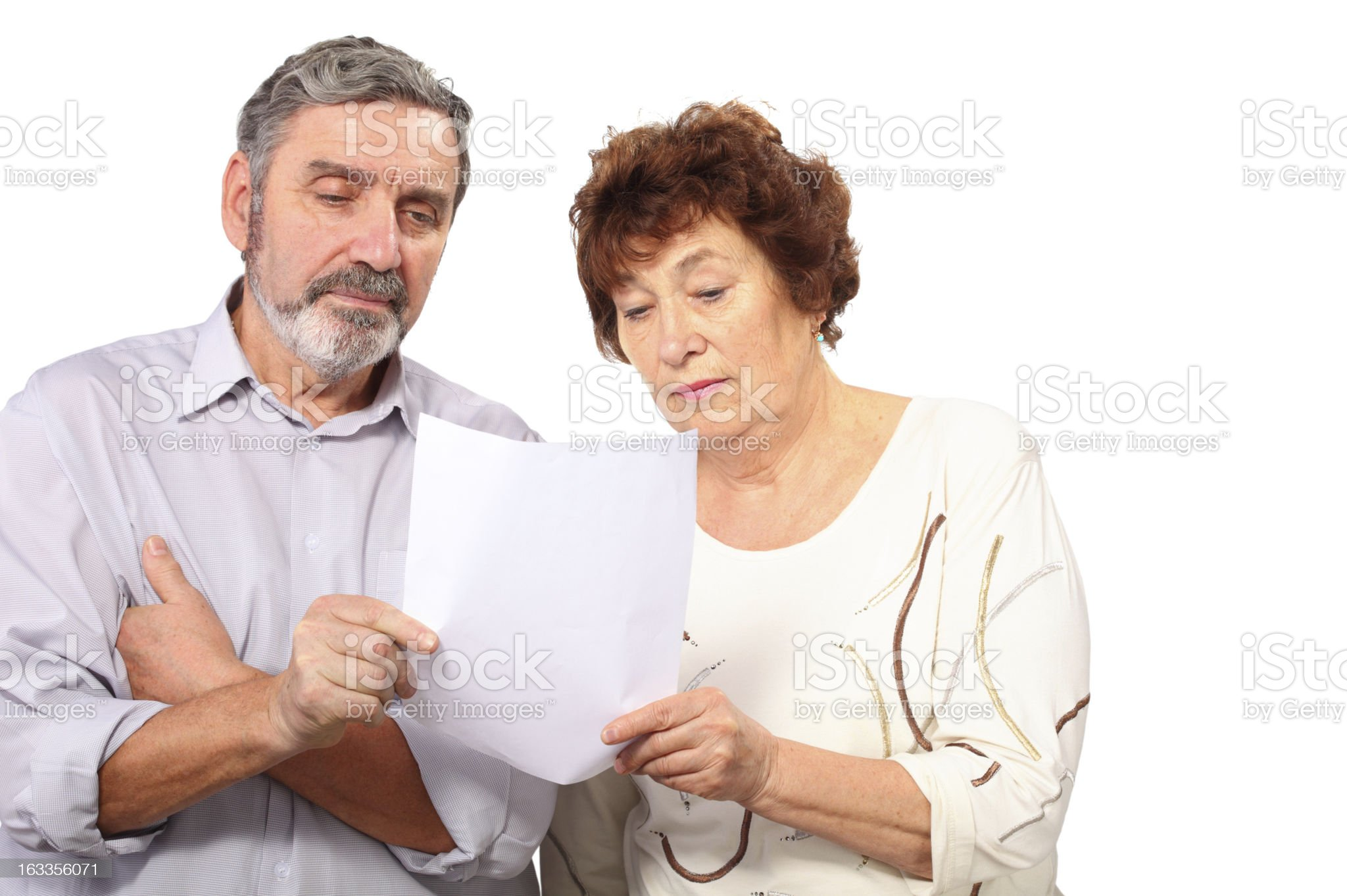 Serious senior couple hold paper list in hands royalty-free stock photo