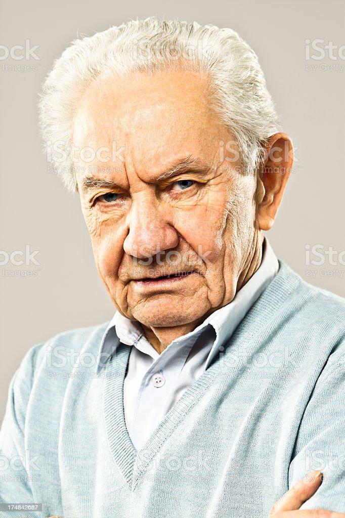Serious senior man looking at camera royalty-free stock photo