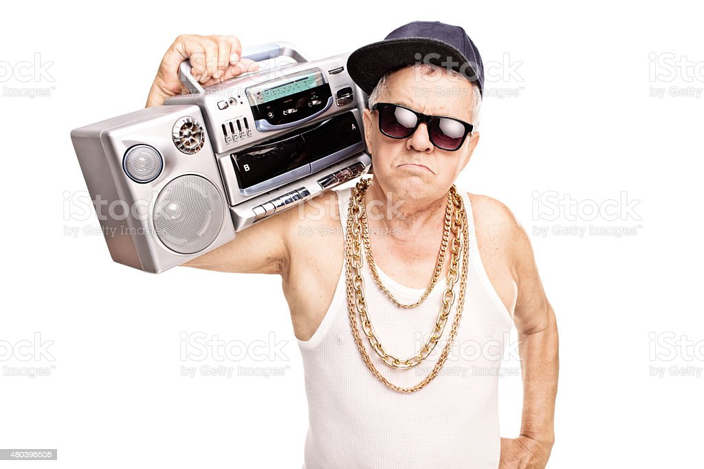 Serious senior rapper holding a ghetto blaster stock photo