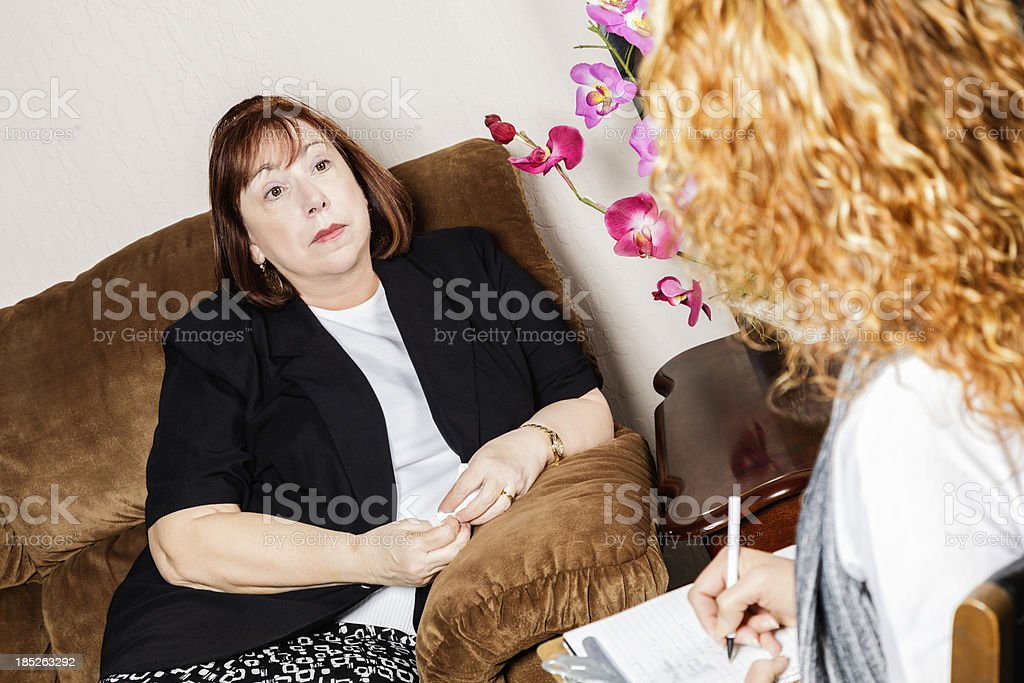 Serious Senior Woman Speaks to Counselor royalty-free stock photo