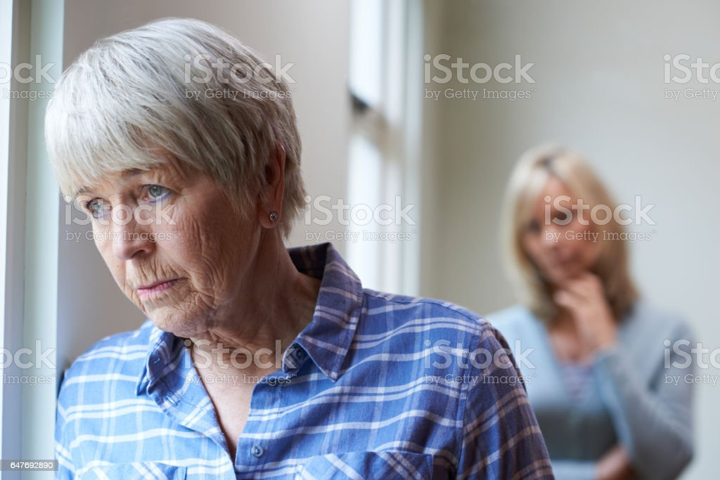 Serious Senior Woman With Adult Daughter At Home stock photo