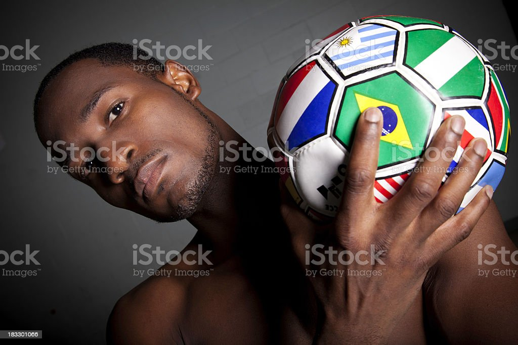 Serious Soccer Player Holding Ball royalty-free stock photo