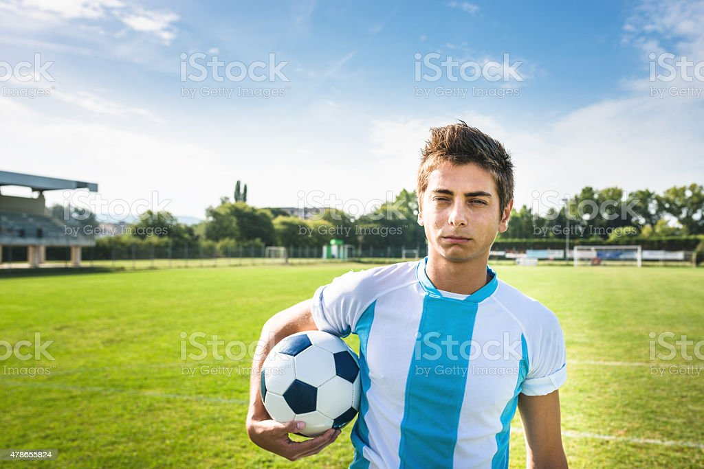 Serious soccer player portrait on the pitch stock photo