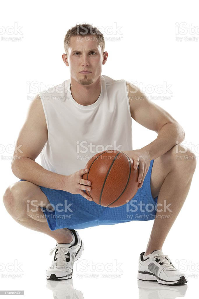 Serious sportsman holding a basketball royalty-free stock photo