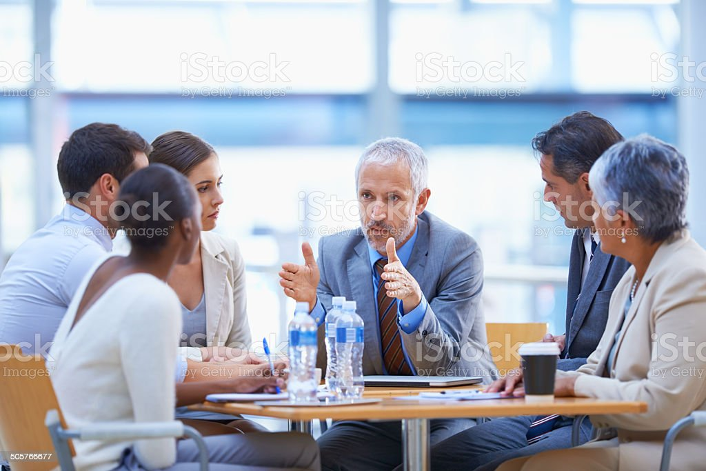 Serious strategising stock photo