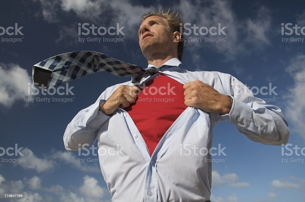 Serious Superhero Businessman Getting Ready for Rescue Blue Sky royalty-free stock photo