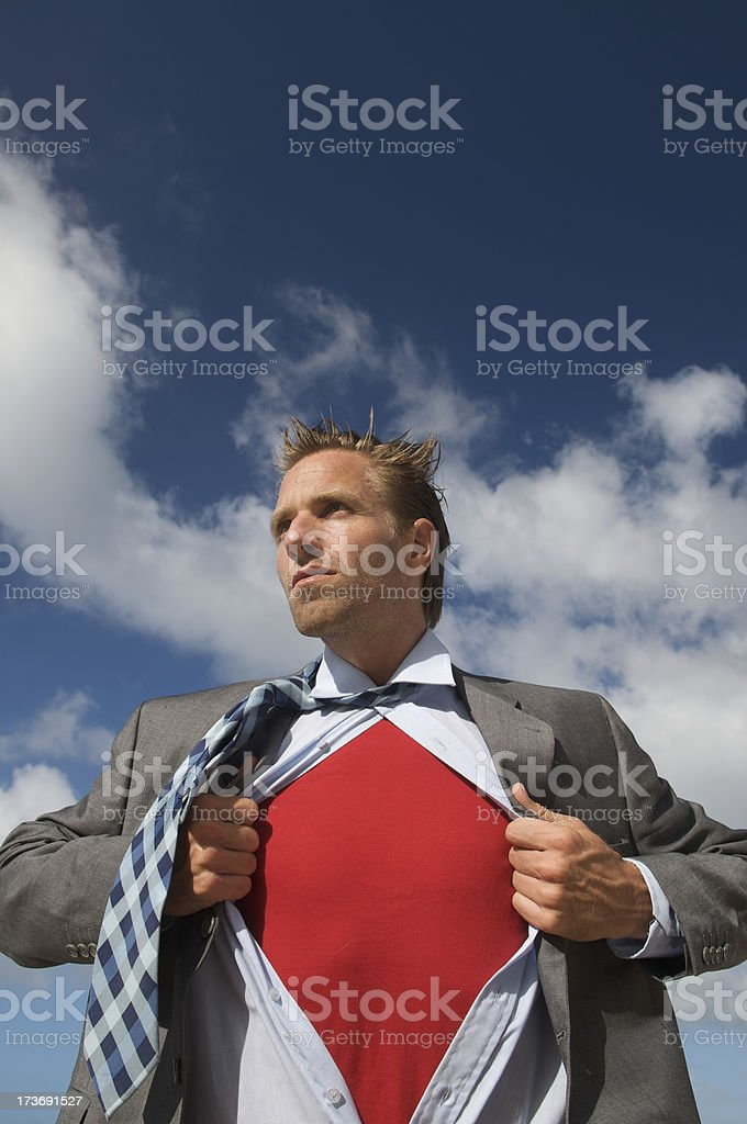 Serious Superhero Businessman Standing Outdoors Bright Sky stock photo