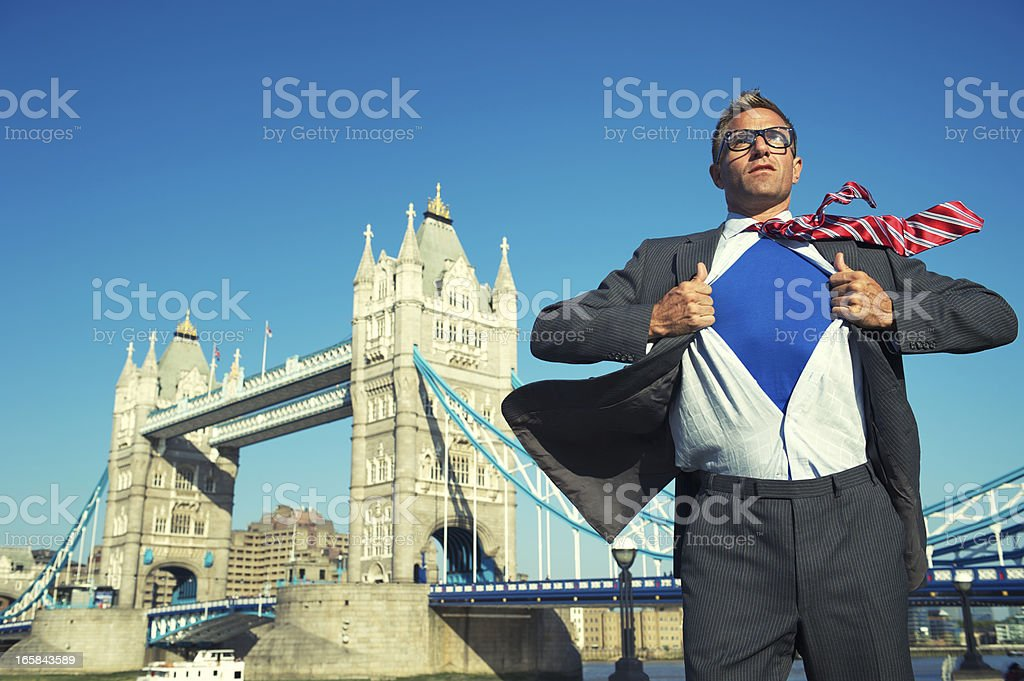 Serious Superhero Stands at London Skyline royalty-free stock photo
