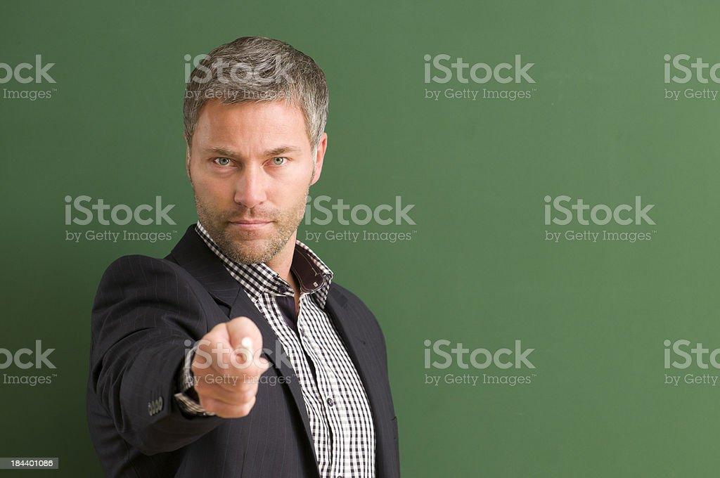 serious teacher directing at camera royalty-free stock photo