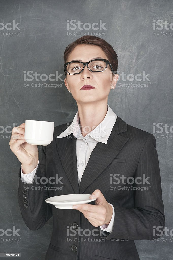 Serious teacher with cup of coffee royalty-free stock photo