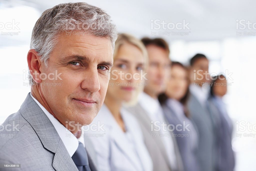 Serious team of executives lined up royalty-free stock photo