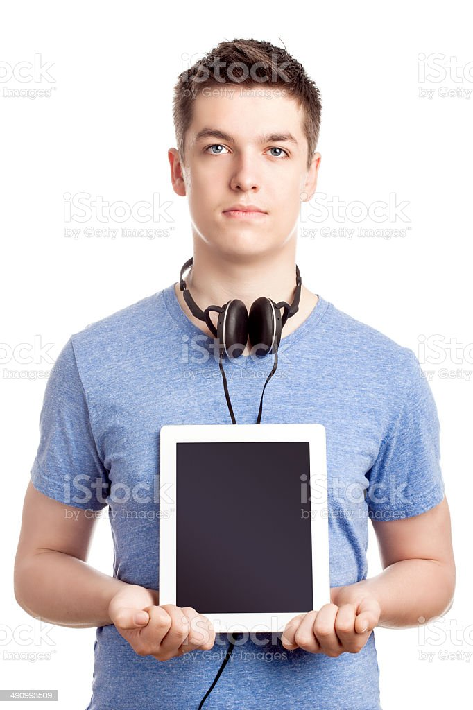 Serious Teenage Boy with a Digital Tablet - Isolated stock photo