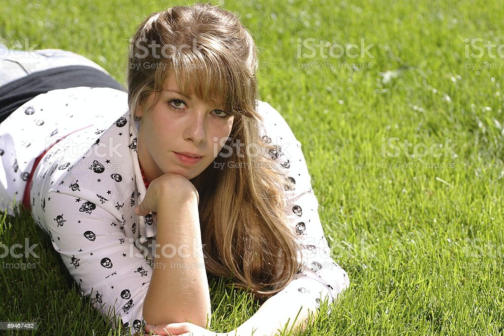 Serious Teenage Girl in the Grass stock photo