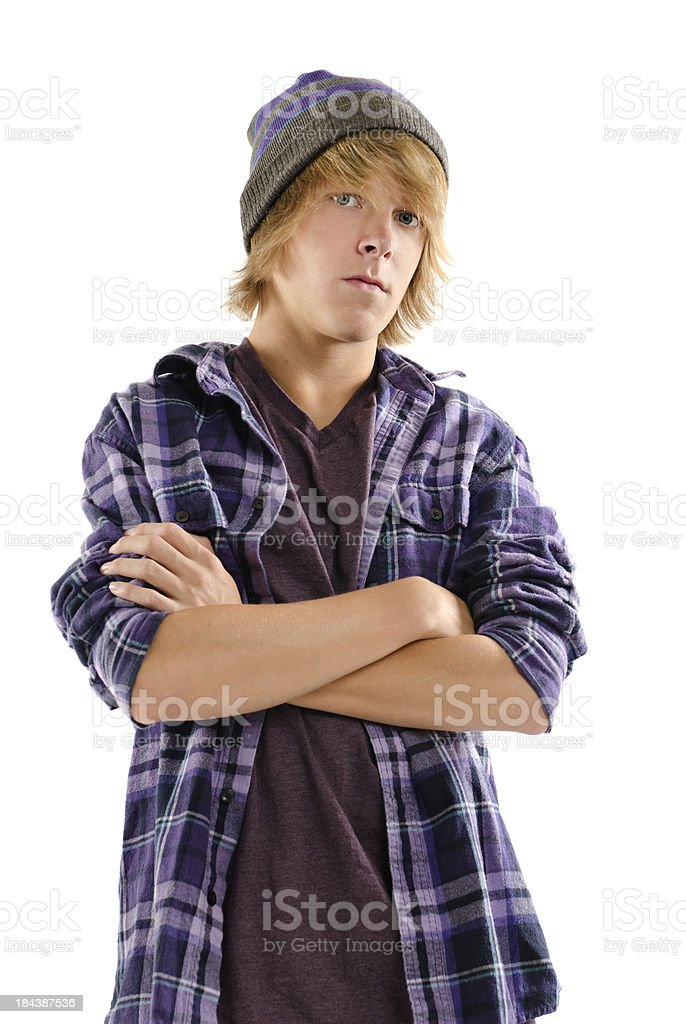 Serious Trendy Teen Boy with Arms Crossed on White stock photo