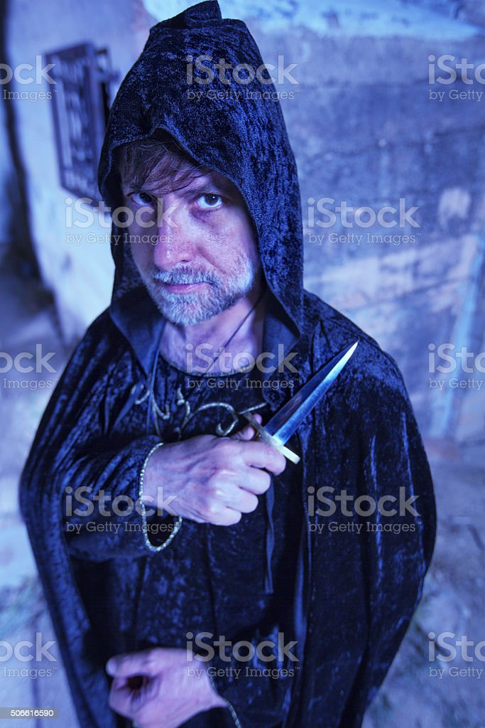 Serious Warlock with Dagger stock photo
