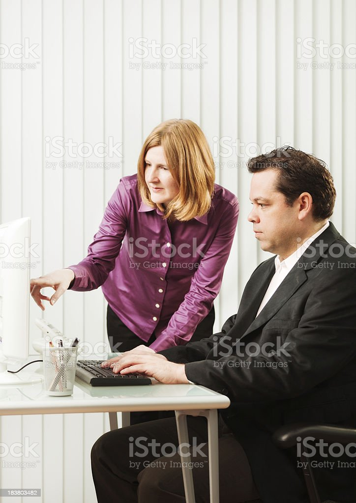 Serious Woman and Man Corporate Office Business Team Working Together stock photo