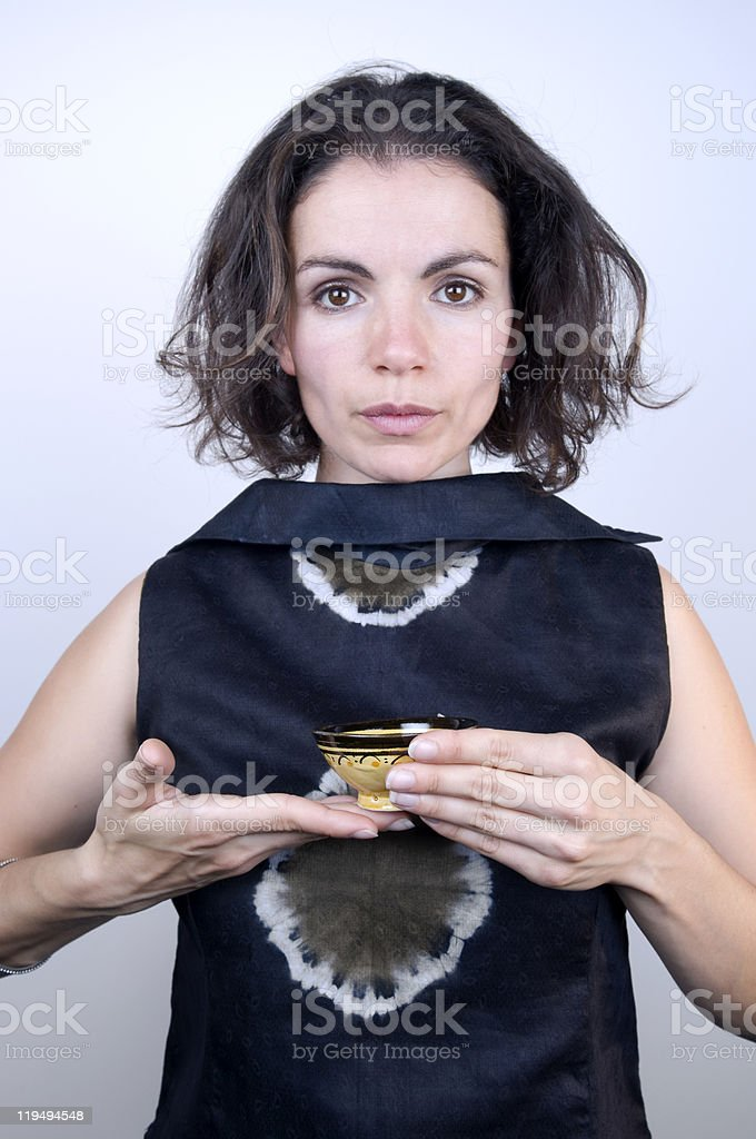 Serious Woman Drinking Tea royalty-free stock photo