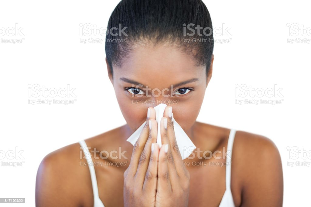 Serious woman has a cold stock photo