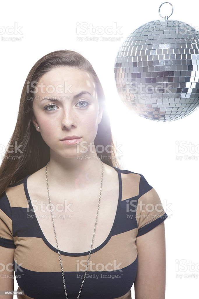 Serious Woman In Front Of Disco Ball royalty-free stock photo
