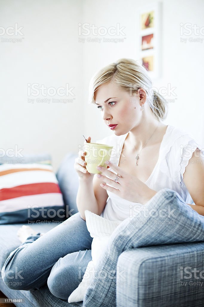 Serious woman in sofa royalty-free stock photo