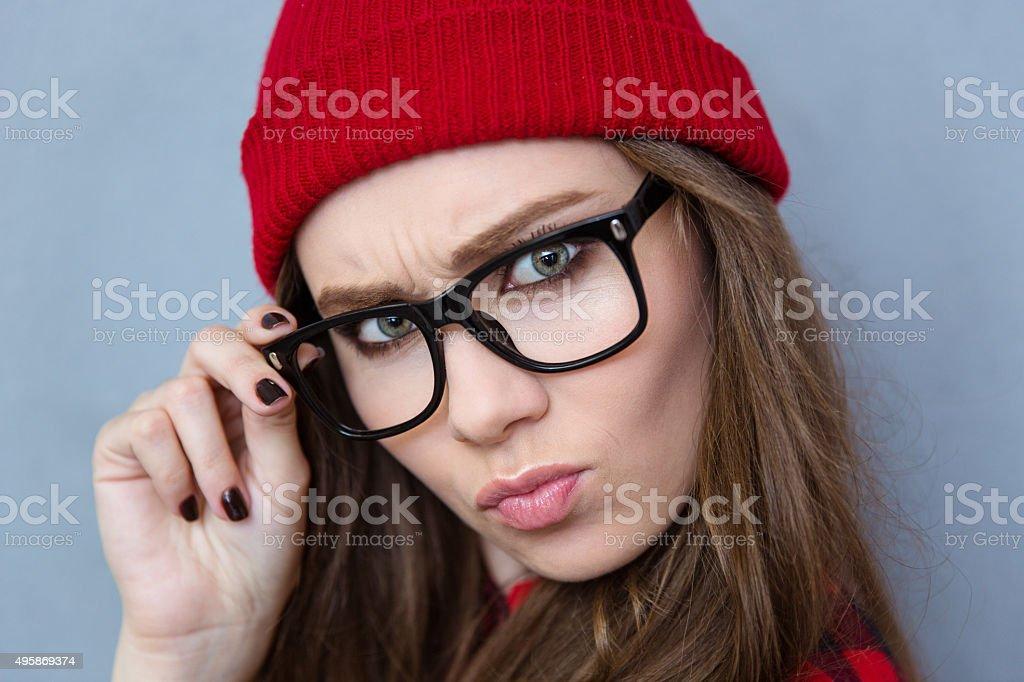 Serious woman looking at camera stock photo