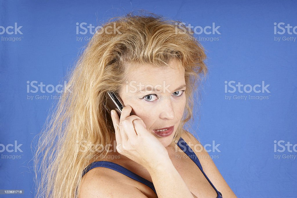 Serious woman on the phone stock photo