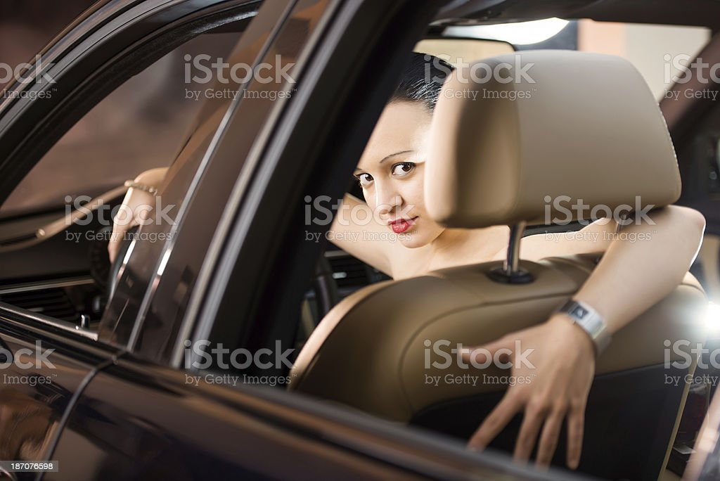 Serious woman sitting in a car. royalty-free stock photo