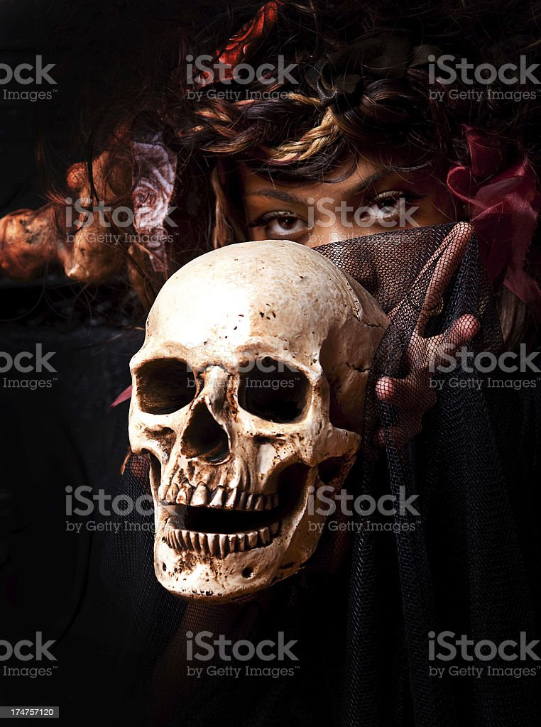 Serious Woman with a Skull royalty-free stock photo
