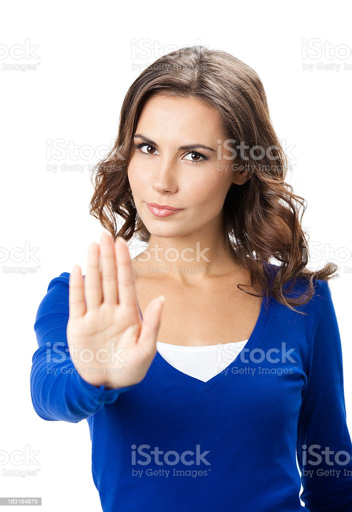 Serious woman with stop gesture, isolated stock photo