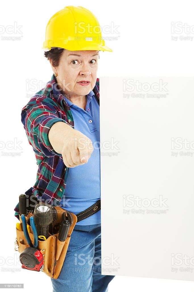 Serious Worker Points with Sign royalty-free stock photo